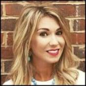 Mandy Hale against brick wall