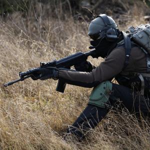 a rifle sniper in a field