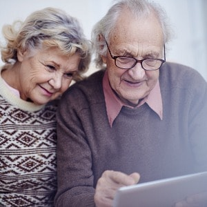 a retired couple on a laptop computer