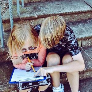 little boy helping a little girl with homework