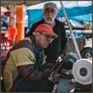 2 men doing manual labor